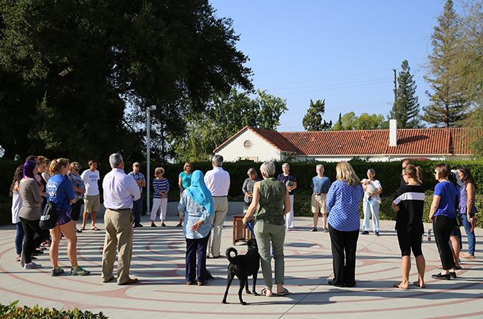 Students, staff, and faculty gather at the Labyrinth for Prayers for Peace.