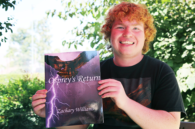Zach Williams '21 with his new novel