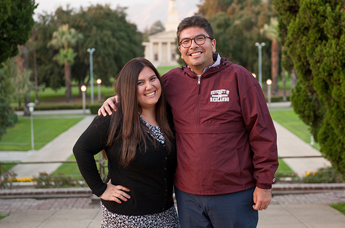 Counseling students Omar and Beatriz stand together on the U of R campus.