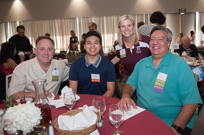 Ryan Bailey (far left) and Al Hernandez (far right), owners of Citrograph Printing Company and co-founders of the Citrograph Foundation, meet one of their scholarship recipients, Justin Tong '22 (second left), in 2019. Also pictured is Associate Director of Athletics Rachel Roche '96, '02, a Citrograph Foundation Board member.