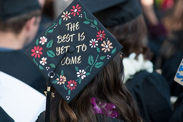 "Graduate with a cap that says ""The best is yet to come"""