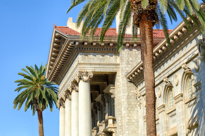 Palm trees frame the facade of the Administration Building.