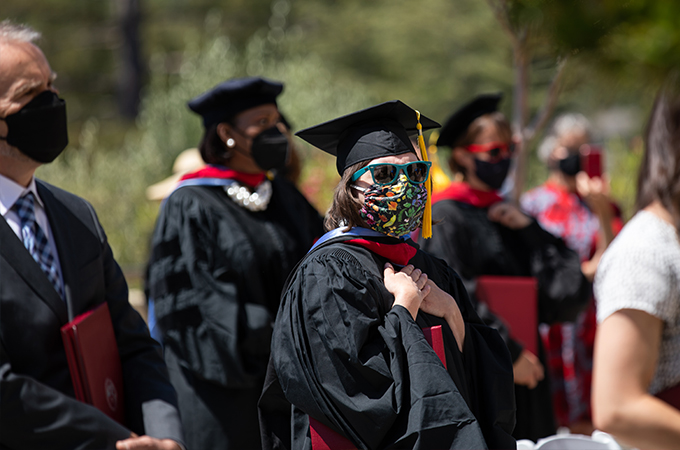 Students from the Graduate School of Theology wear masks and participate in a Commencement ceremony.