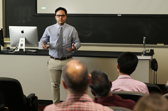 A University of Redlands professor presents his research during a faculty technology grant showcase.