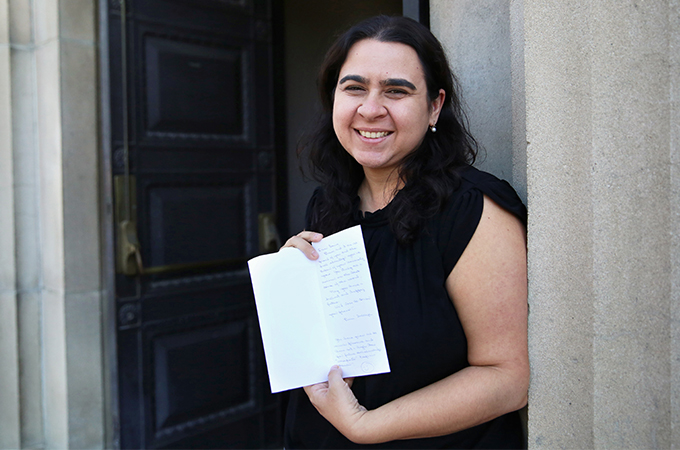 Laura Gallardo holding the letter the