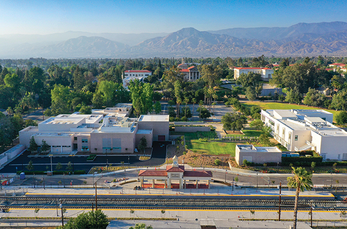 An aerial view of the new U of R train station, with mountains in the background.