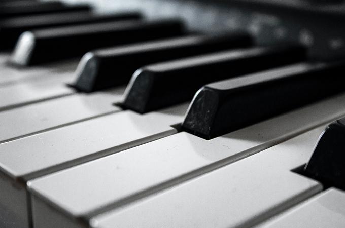 A black and white macro photo of piano keys.