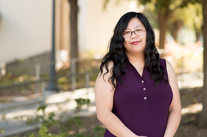 """I wanted to see what other women have done in order to succeed, whether that is through peer mentorship in their cohort, faculty mentorship, or something else,"" says Mai Vang '18, '22, who decided to focus her dissertation on the experience of mothers of color in graduate school after realizing that there wasn't much research conducted about that population. (Photo by Coco McKown '04, '10)"