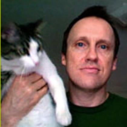 Greg Bills with his cat
