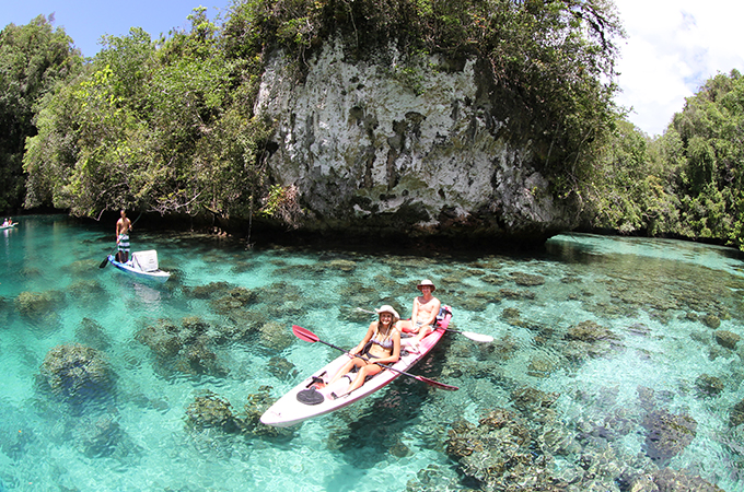 Students kayak in the clear waters of Palau