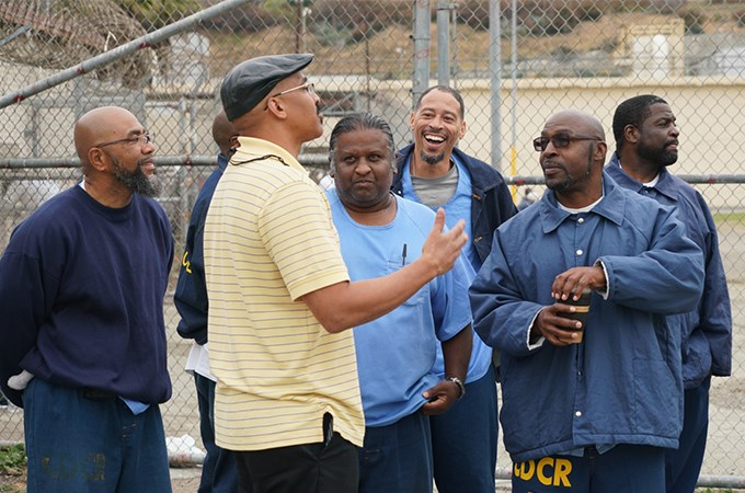 Rev. Stewart Perrilliat '16 (front), a Doctor of Ministry student at San Francisco Theological Seminary at the University of Redlands, speaks with inmates at San Quentin State Prison. (Photo by Matt Anderson)