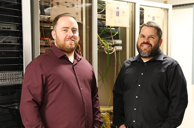 Alton Edenfield II (left) and Alex Irigoyen work in the University's Information Technology Services department and see a need for a conference that caters to IT professionals in the Inland Empire. (Photo by Emily Tucker)