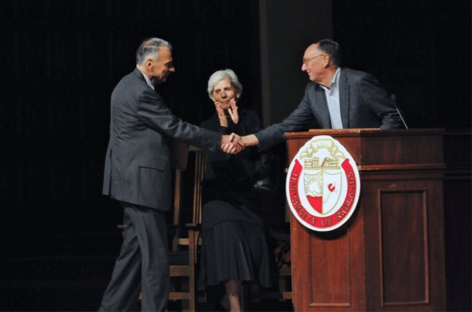 Political activist Ralph Nader (left) is one of the many well-known figures who has spoken at the Redlands Forum. Here, Nader greets Jack Dangermond, co-founder and president of Esri, in a 2011 appearance with sister Claire Nader. (Photo by Carlos Puma)