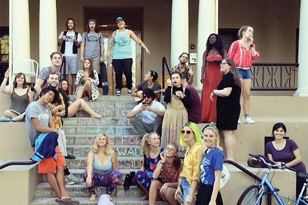 Many students on the Bekins Hall stairs