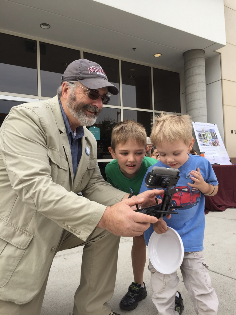 Dr Moore showing kids the drone controls