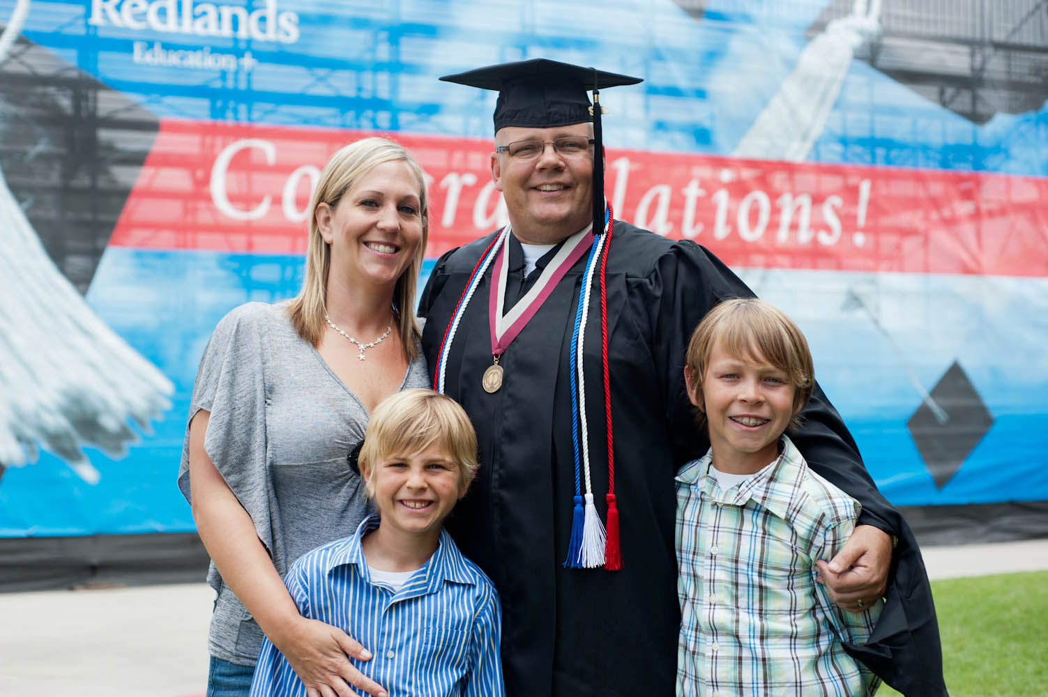 Commencement Graduate with family