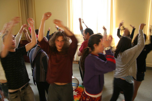 Students and community members learn meditation movements during the Sufi dance session led by Murshida Tasnim Fernandez.