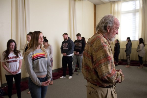 Dr. William Huntley Jr. leds students in  Walking Meditation.