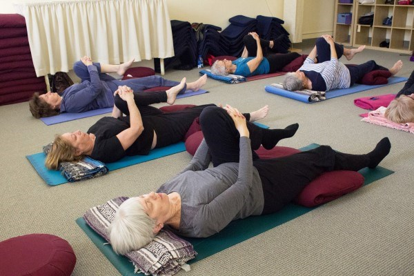 Community members practice Restorative Yoga, led by Pat Geary.