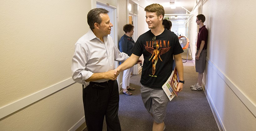 President Kuncl greeting new student