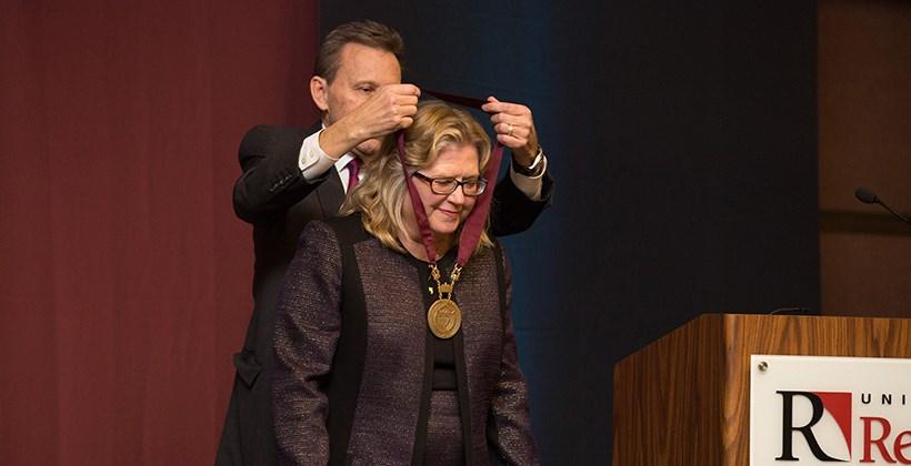 President Kuncl installing Kathy Ogren as Provost