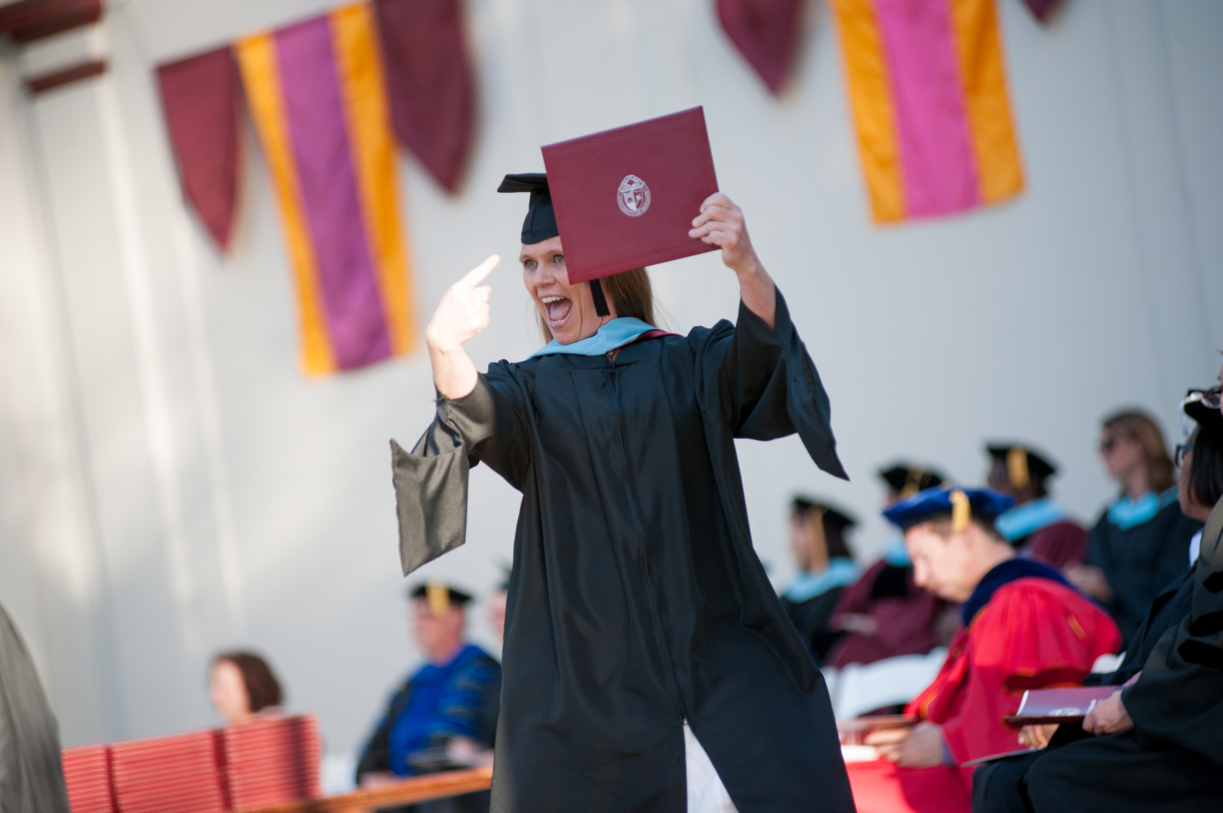 Graduate Excited about Diploma