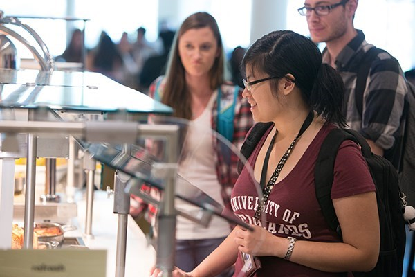 Students in line to receive their food in the Irvine Commons