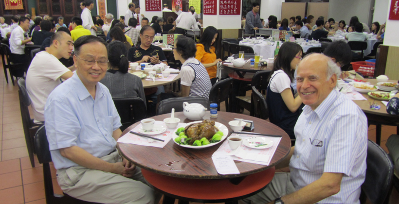 James Pick eating dinner with Professor K. Hung Chan in Hong Kong