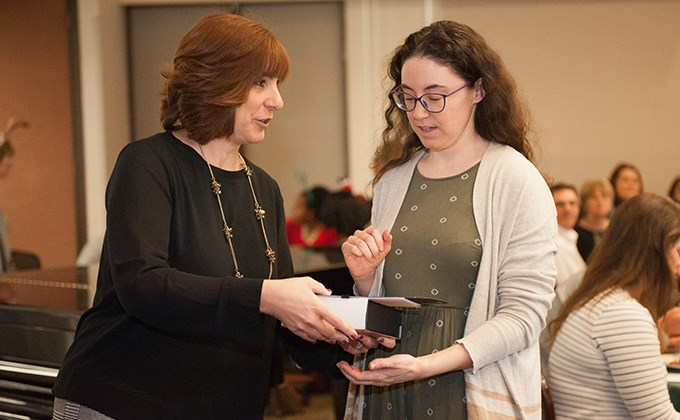 Michelle Rogers giving Emily Croft a President's Award
