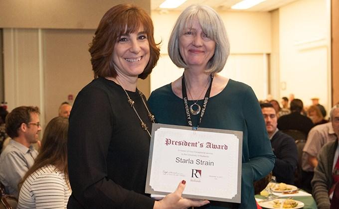 Michelle Rogers giving Starla Strain a President's Award