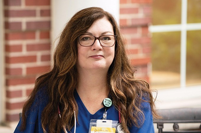 """""""We are seeing an increase in the acuity of depression and anxiety as more  and more people reach out for services to help themselves cope with their  new realities during the pandemic,"""" says Julie Craig '02 (M.Div.). (Photo by Kat Schleicher)"""