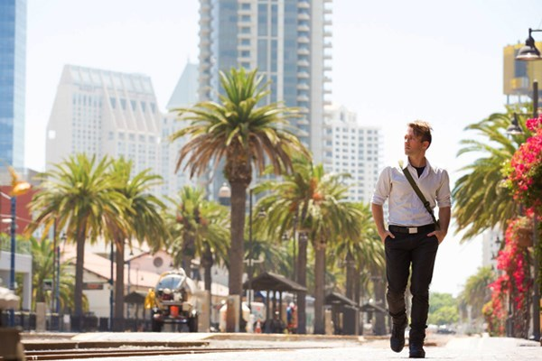 young professional walks in southern california