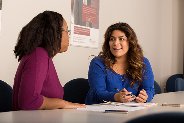 women engaging in conversation