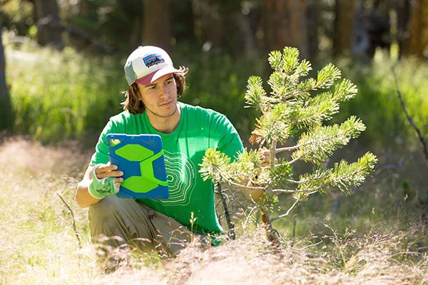 Student examines wild plant