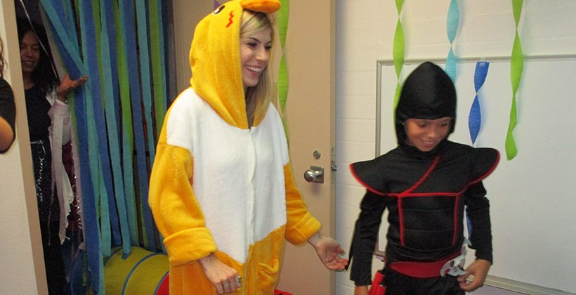 Student and client having fun at the Truesdail Halloween carnival